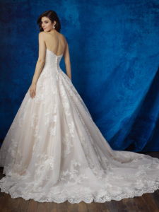 Scalloped edging and layered tulle introduces a delicate play of textures into this strapless ballgown.
