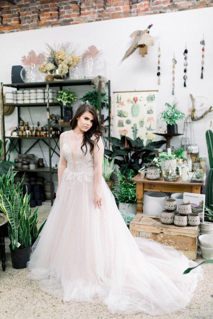 Designer bridal gown available at top Bridal Shop Sophia's Bridal & Tux
