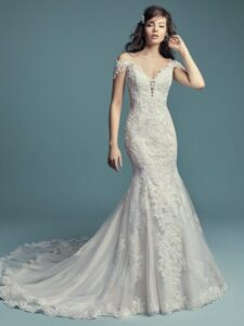 Beaded lace motifs and Swarovski crystals cascade over tulle in this fit-and-flare wedding dress, featuring an illusion double-lace train. Beaded spaghetti straps complete the illusion plunging sweetheart neckline and illusion scoop back, both accented in lace motifs. Attached cold-shoulder sleeves accented in lace motifs can be removed easily to fit a bride's preference. Finished with covered buttons over zipper closure.