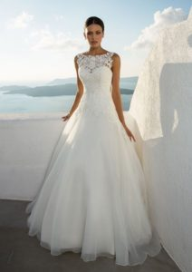 Your day will be complete with this fairytale gown. Features a Sabrina embroidered lace bodice with appliques continuing into the top of the tulle A-line skirt.