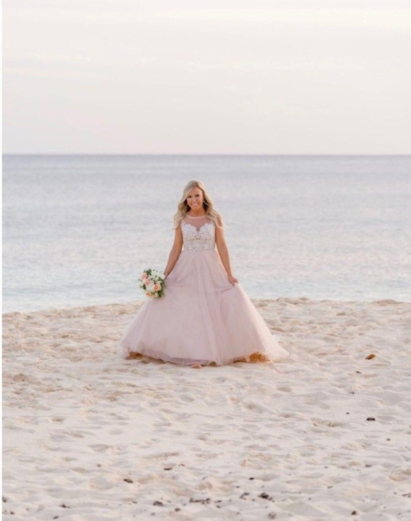 Bride on beach in Grand Cayman for destination wedding.