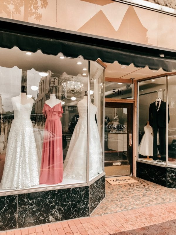Columbus Indiana Bridal Boutique selling dresses tuxedos formalwear and prom dresses front window.