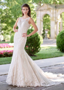 fitted martin thorn burg wedding dress with shoulder straps and lace and plunging neck with lace overlay
