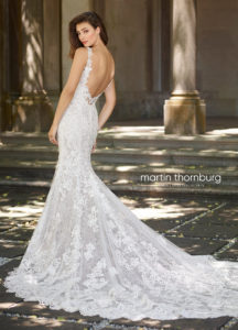 fitted martin thorn burg wedding dress with sleeves and lace