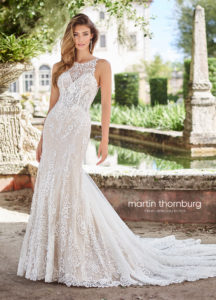 fitted martin thorn burg wedding dress with shoulder straps and lace and high neckline