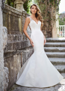 simple and fitted martin thorn burg wedding dress with shoulder straps and lace