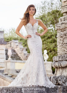 fitted martin thorn burg wedding dress with straps and lace