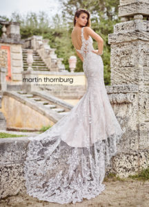fitted martin thorn burg wedding dress with sleeves and lace and long train
