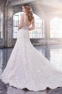 fitted martin thorn burg wedding dress with shoulder straps and lace and beaded back