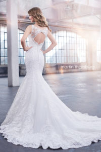 fitted martin thorn burg wedding dress with shoulder straps and lace and keyhole back