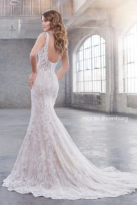 fitted martin thorn burg wedding dress with shoulder straps and lace and low back