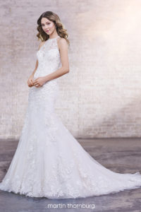 fitted martin thorn burg wedding dress with shoulder straps and lace and high neck