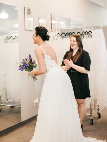 bride finding her wedding dress at Sophia's bridal A line lace wedding dress with tulle skirt