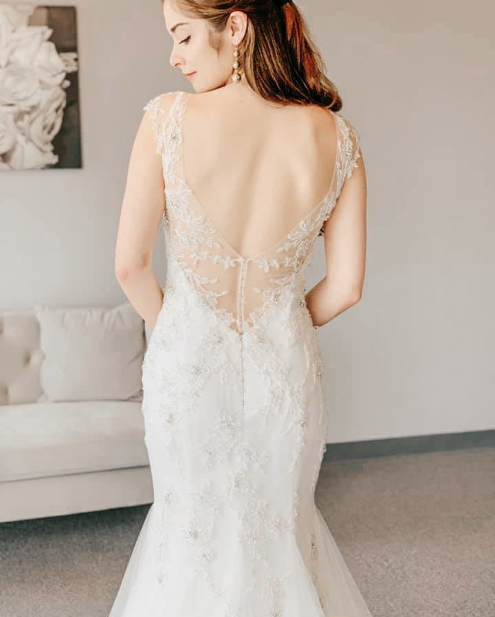 gorgeous beaded lace wedding dress fitted with low back at our fishers Indianapolis Sophia's bridal boutique