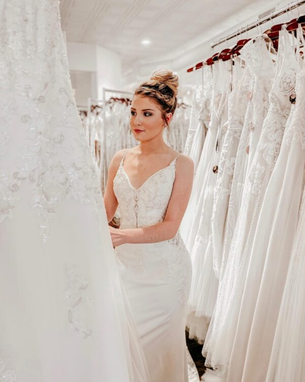 shop for your bridal dress at Sophia's Bridal with lots of racks of dresses