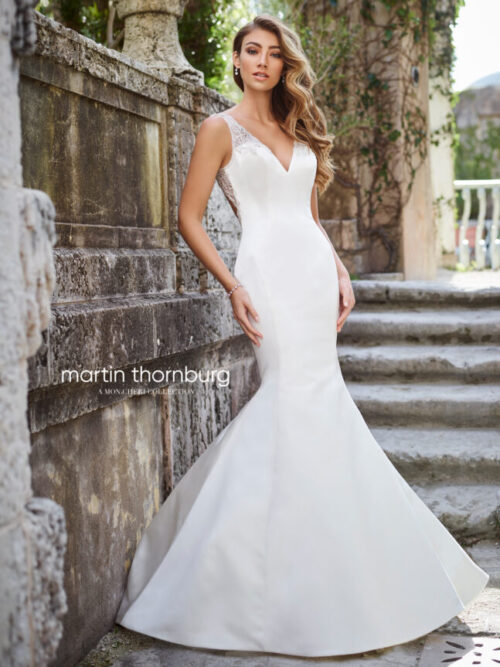 Simple modern wedding dress with sleek satin front and beaded straps and back mermaid style wedding dress