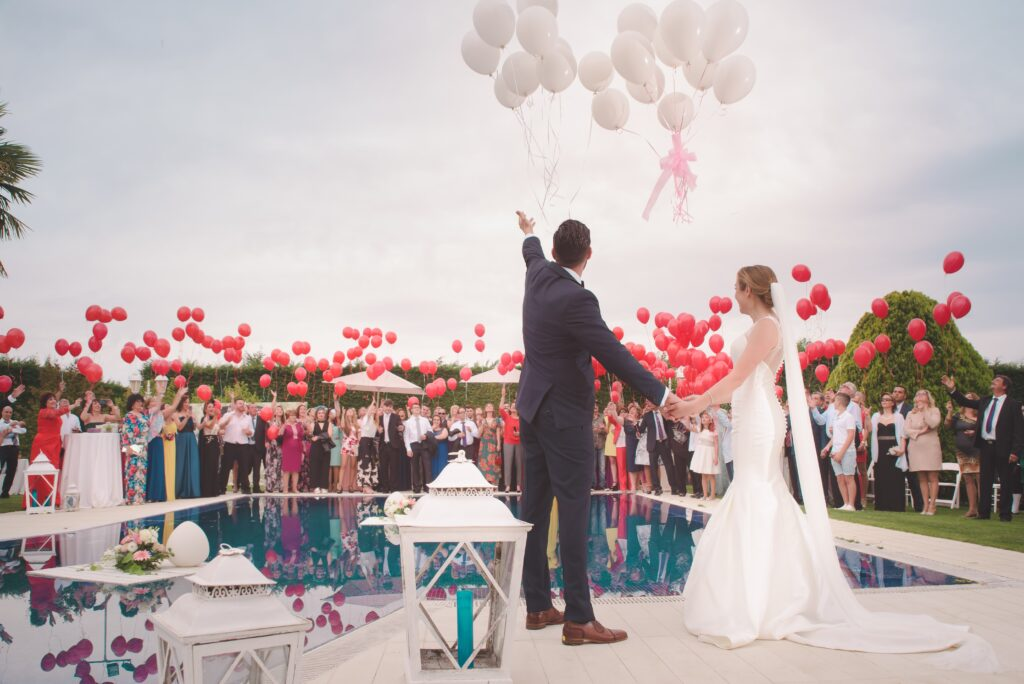Balloons at a wedding with bride and groom and wedding party