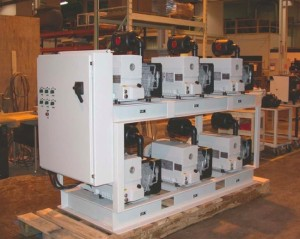 Industrial vacuum systems for roughing and backing high vacuum pumps