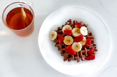 Cup of tea and waffles with fruit
