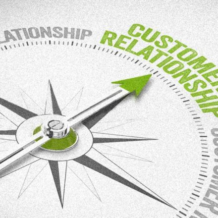 compass with needle pointing to customer relationship
