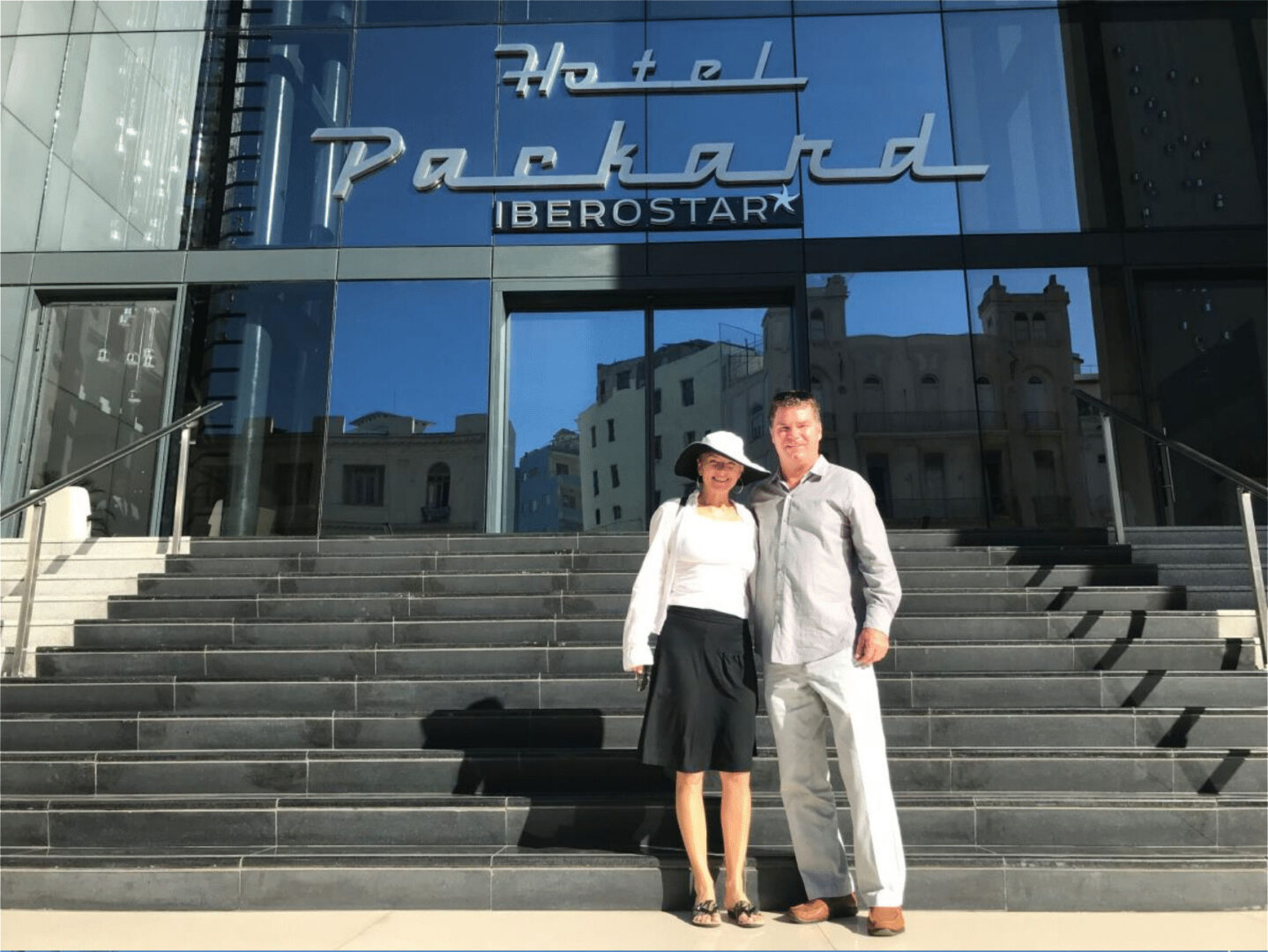 A couple in front of a hotel
