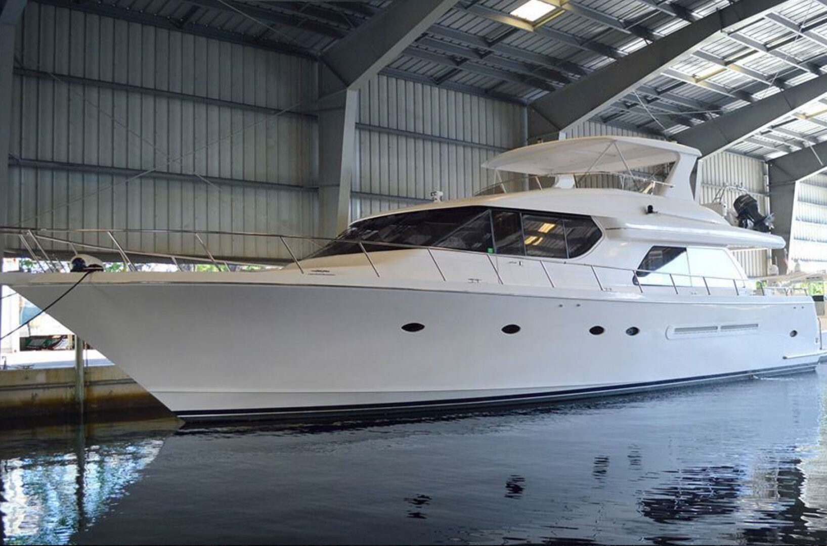 A Carol C yacht in a covered dock