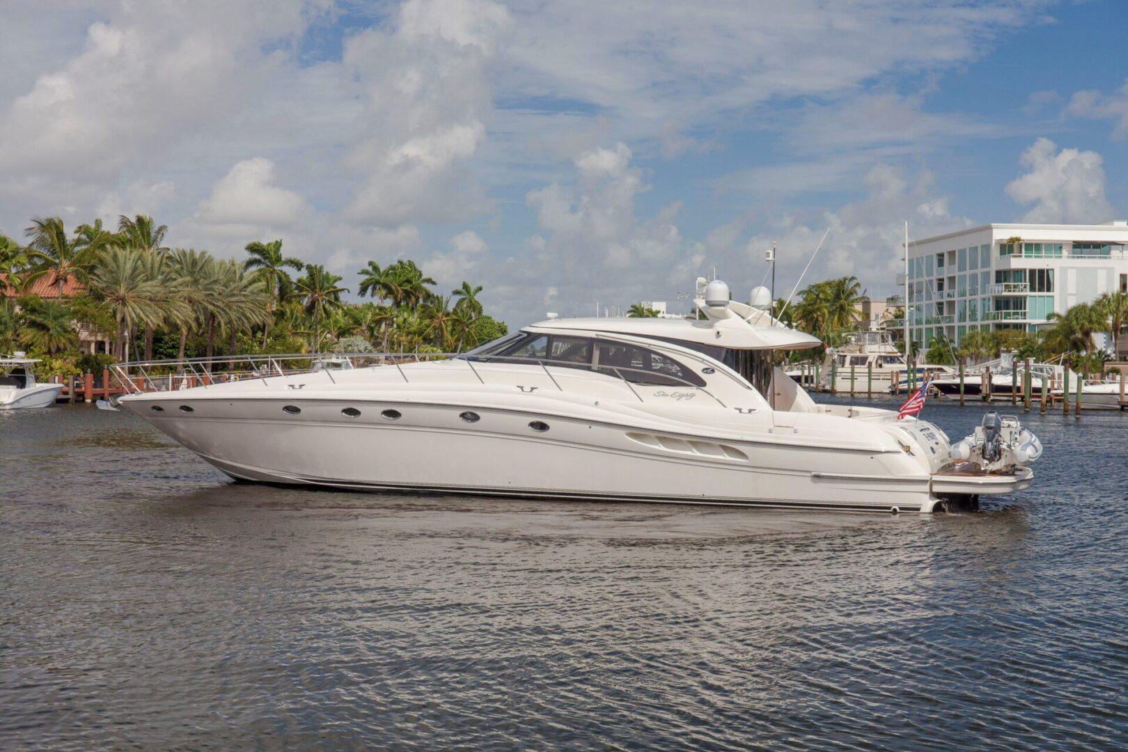 An Enuff yacht yacht near the docks