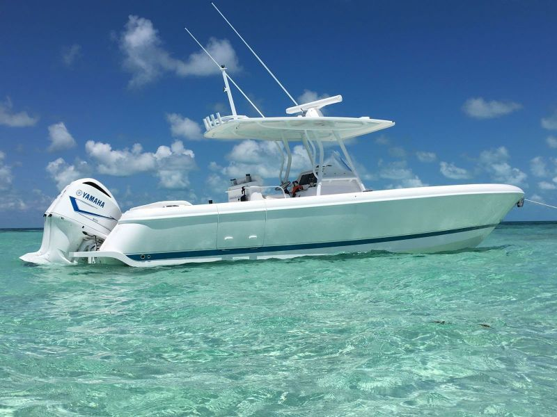 A Never Say Never yacht on shallow water