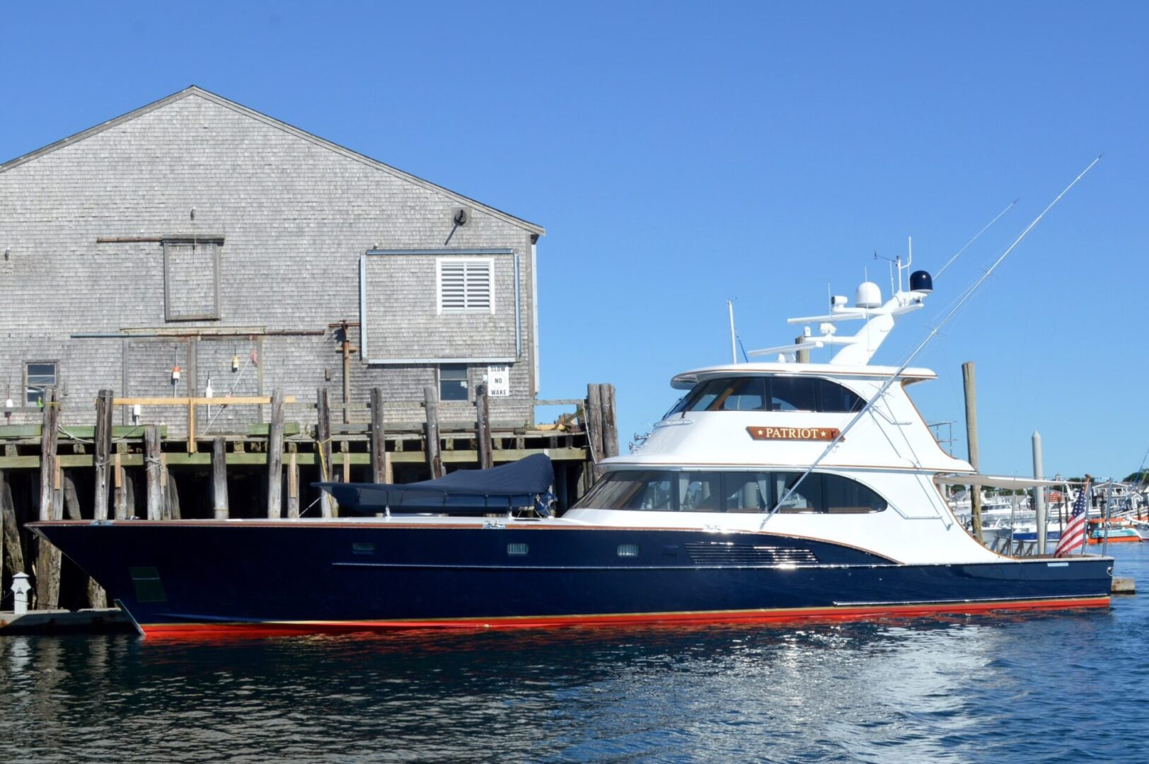 A blue and white Patriot yacht