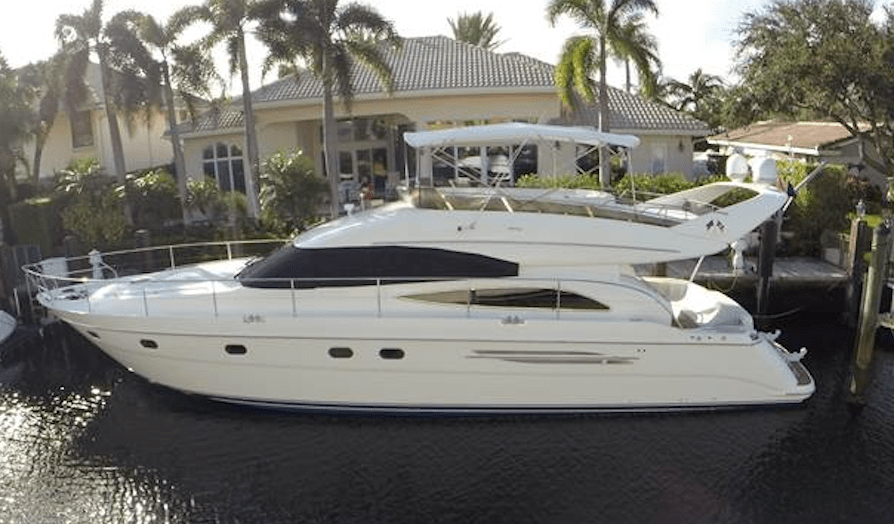 A Sempre Fi yacht docked at a waterfront