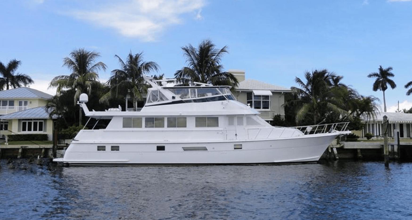 A Wynsong docked near a house