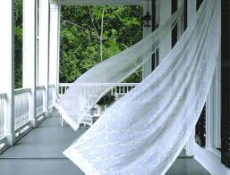 curtains waving in the breeze on a porch