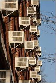 brick building with window air conditioners