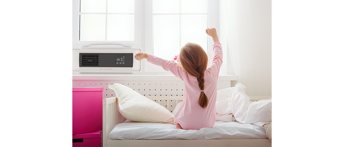 young girl waking up with an EcoBreeze 2 smart window fan
