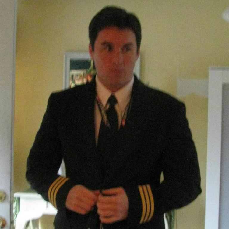 Pilot fixing his uniform.