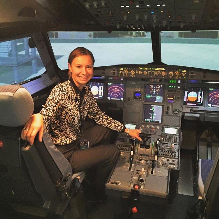 A woman inside the cockpit.
