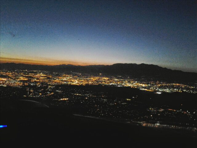 Aerial view of the city lights at night.