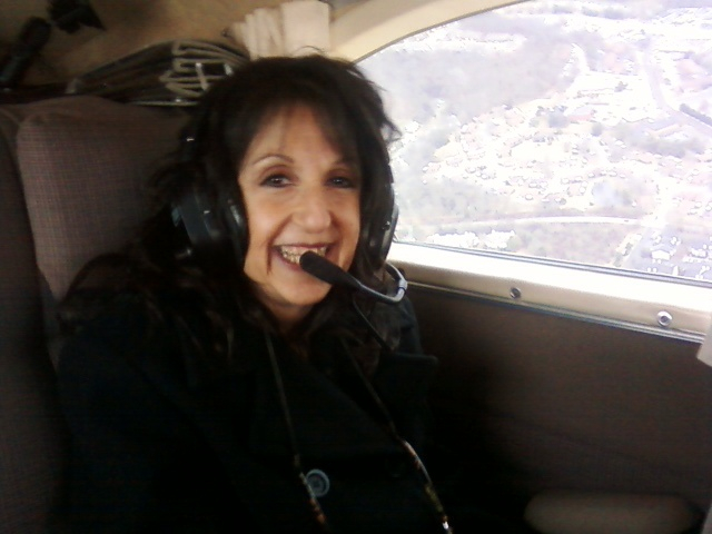 A woman with an aviation headset.