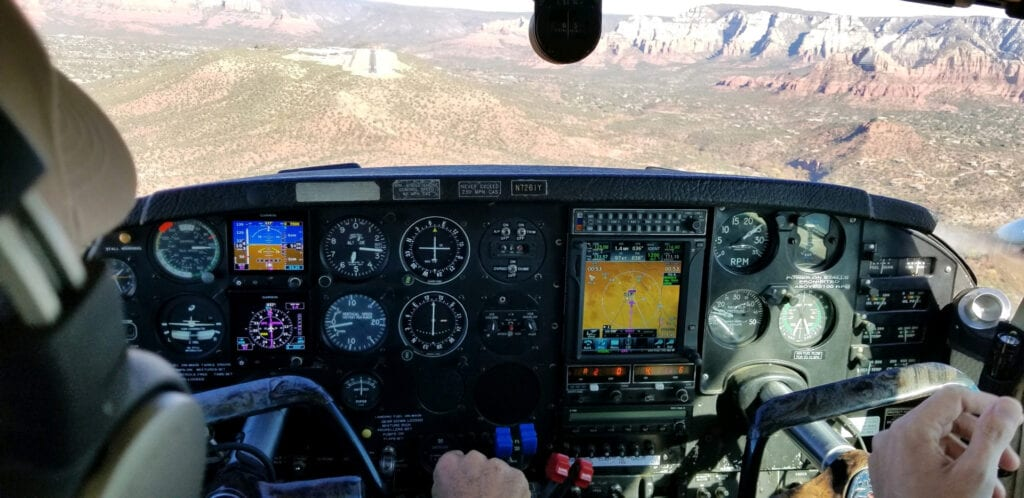 View of the desert from a plane cockpit.