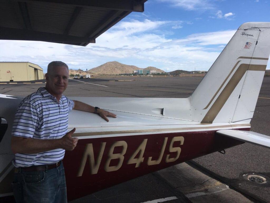 Caucasian man posing with an aircraft.