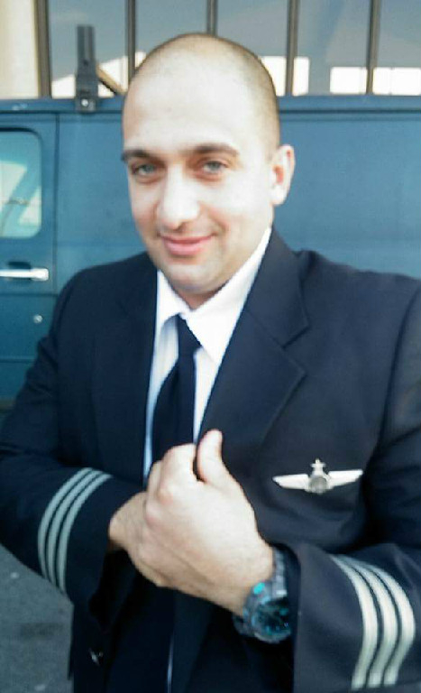 A man in a pilot uniform.