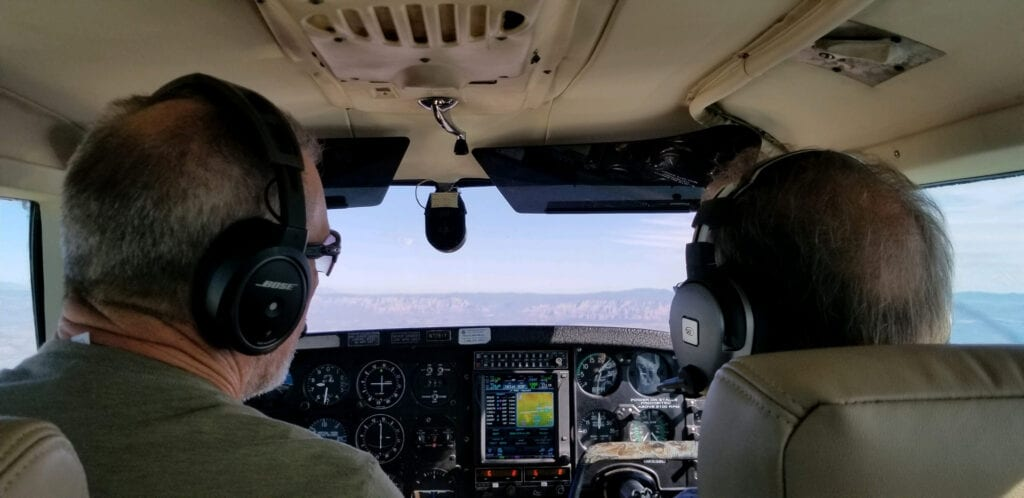 Two men flying a plane.