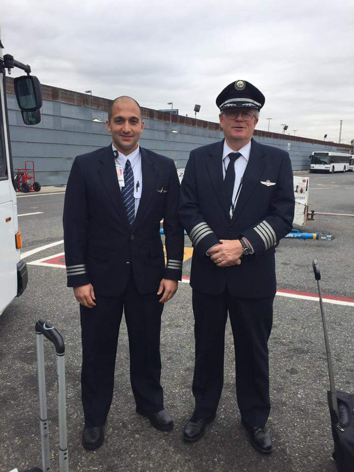Two pilots standing next to each other.