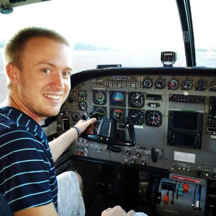 A man navigating an airplane.