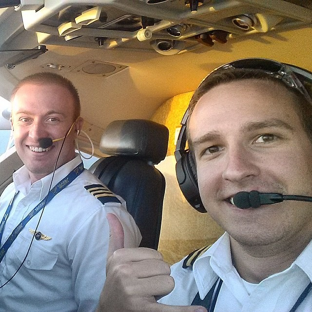 Two male pilots smiling.