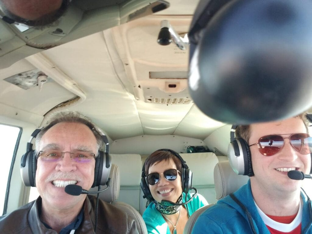 Three people inside an aircraft.
