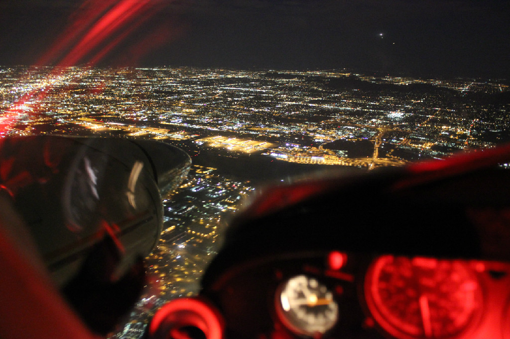 Flying over the city at night.