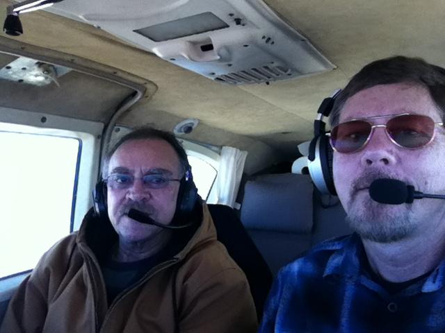 Two men inside an aircraft.
