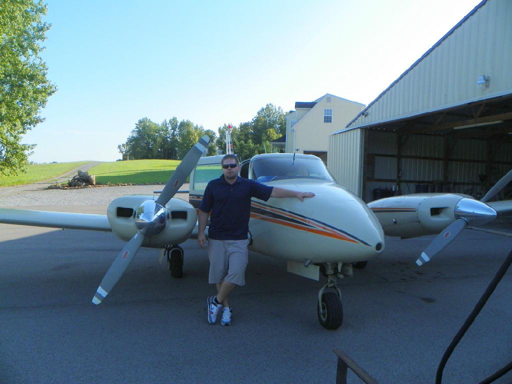 A Caucasian man touching an airplane.