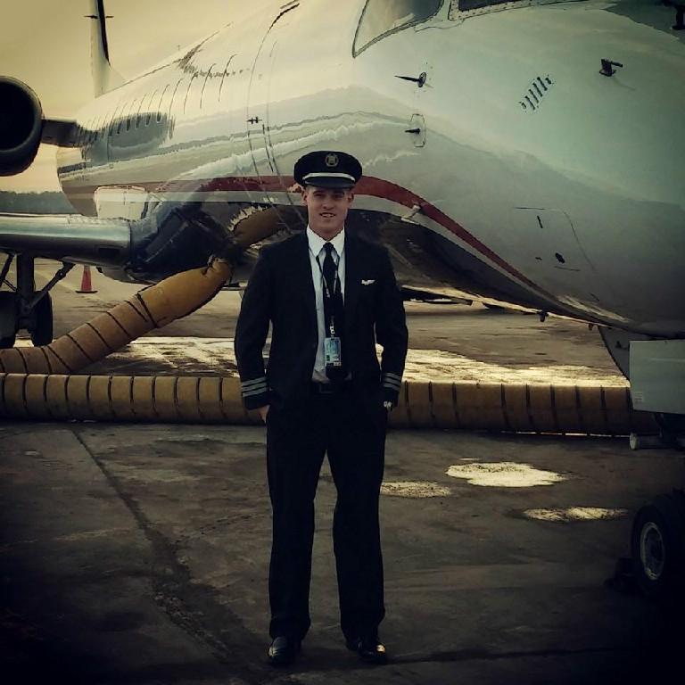 A pilot smiling.
